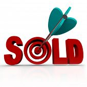The word Sold with an arrow striking a bullseye target, representing a transaction that has been completed between a buyer and a seller, successfully transferring ownership of an object poster