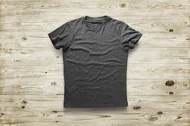 Dark grey shirt over light wood background