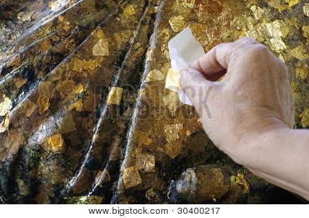 Gold Foil on Statue with Hand Sticking
