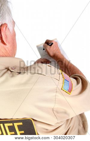 Police man writing a ticket. Police officer issuing a speeding or traffic ticket. Isolated on white. Room for text.