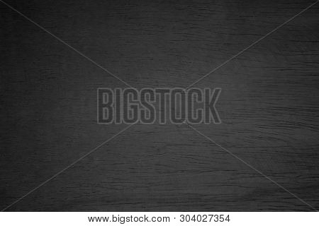 poster of Black wood texture background. Abstract dark wood texture on black wall. Aged wood plank texture pattern in dark tone. Rustic black floor old wood. Black wood texture with space. Black rough texture background. Black wood surface background
