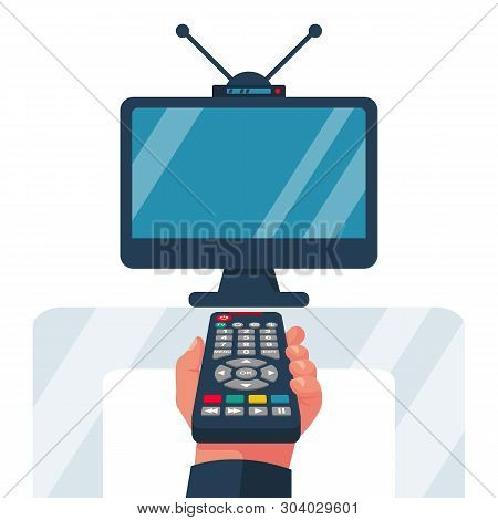 Turn On The Tv. Remote Control Holding In Hand. Social Media. Rest At Home, While Watching Programs.
