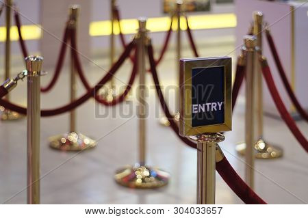 Entry / Exit Sign Against Rope Barrier Stanchion Queue Rope Barrier Posts Stands Crowd Control