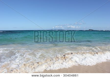 Caribbean Sea with shades of beautiful blue waters and St Barts in distance