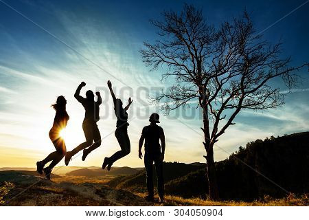 Silhouette Of People. People In Jump. Friends Have Fun At Sunset. Funny Friends. Best Friends. Frien
