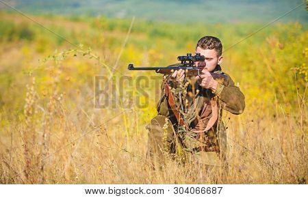 Man Hunter Aiming Rifle Nature Background. Experience And Practice Lends Success Hunting. Guy Huntin