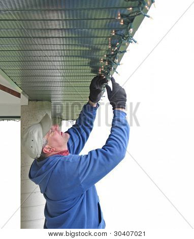 Man installing Christmas lights