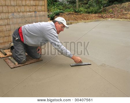 Man finishing concrete slab