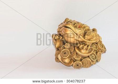 Cash Mascot - Chan Chu - A Gold Frog Figurine Sitting On Coins Isolated On White Background, Feng Sh