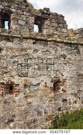 Brick Wall With Arrowslits (arrow Loops, Loopholes, Loop Holes, Balistrarias, Embrasures). Ruins Of
