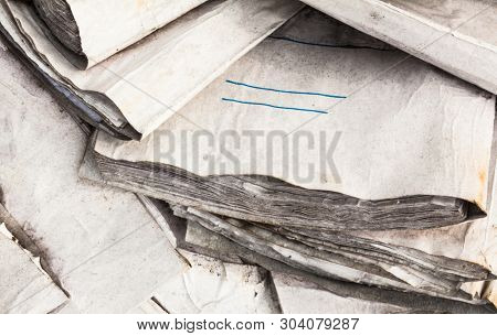 Pile Of The Old Useless Paper Documents On The Landfill.