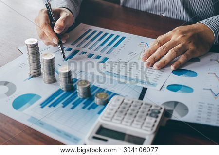 poster of Businessman accountant counting money and making notes at report doing finances and calculate about cost of investment and analyzing financial data, Financing Accounting Banking Concept.