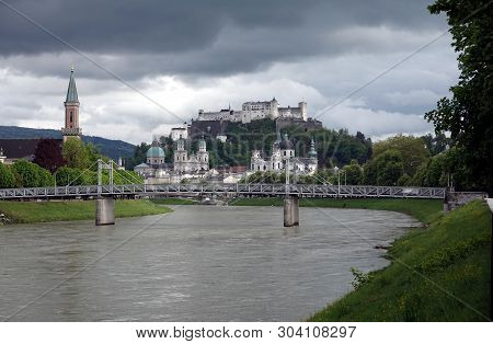Landscape, With Hohensalzburg Castle On Festung Mountain In Salzburg, Austria. View From The Bridge