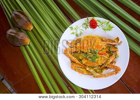 Fried Crab With Curry Powder Is Delicious,leaves Background.