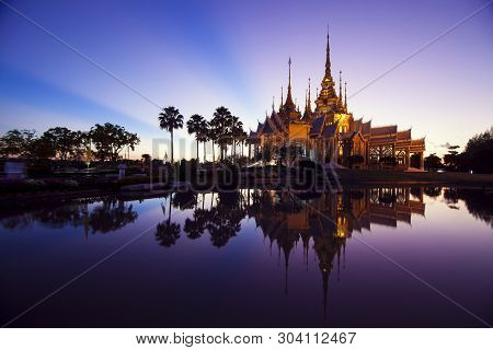 A Beautiful Golden Temple In Reflection In Twilight , Nakorn Ratchasrima , Thailand
