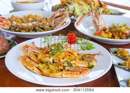 Dishes With Various Seafood At Dinner Table, Selective Focus,mantis Shrimp,fried Crab With Curry Pow