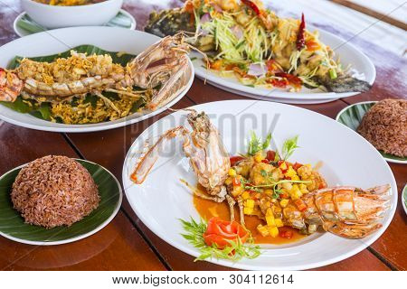 Dishes With Various Seafood At Dinner Table, Selective Focus, Mantis Shrimp,
