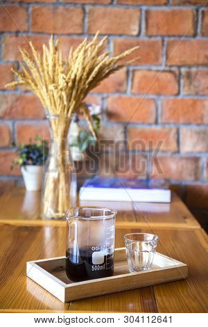 Drip Coffee Served Set Of Drinks, Wood And Brick Wall Background.