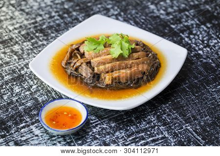 Selective Focus Of Braised Pork In A Sweet Soy Sauce