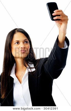 cute businesswoman taking a self portrait with her cell phone