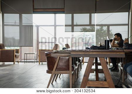 Business People Working In Co-working Space Office. Corporate Staff Employees Working Together Using