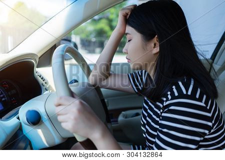 Stressed Asian Woman Driver Sitting In Car Having Headache Stop After Driving Car In Traffic Jam.  E