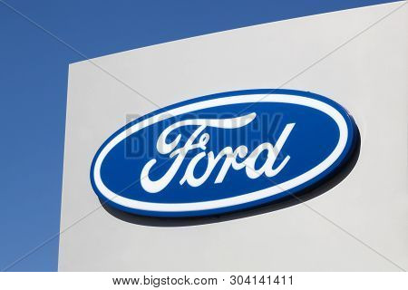 Risskov, Denmark - May 11, 2019: Ford Logo On A Wall. Ford Is An American Multinational Automaker He