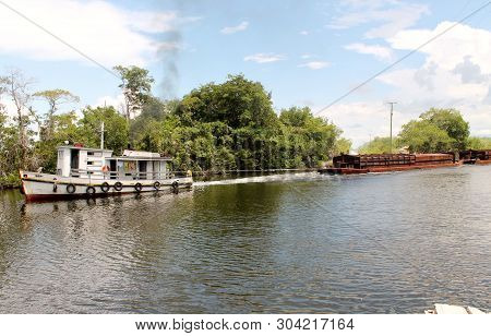 Belize, Central America - Circa 2016 - River Tug Tows A Sugar Cane Barge On The Main River Belize.