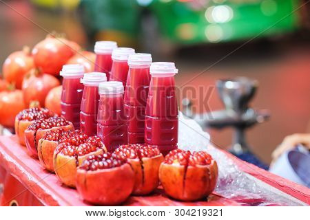 Pomegranate Fruit And Juice Bottle Drink At Yaowarat Thailand For Background Or Texture - Healthy Co
