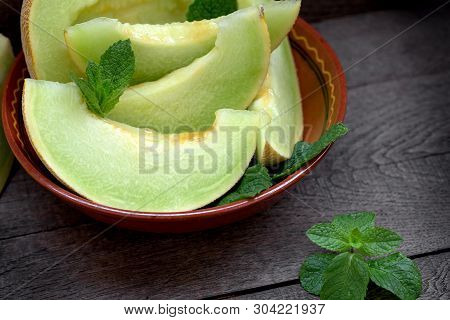 Melon Slices In Rustic Bowl, Organic And Juicy (succulent) Melon - Slices Of Cantaloupe Close-up