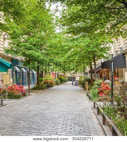 A Quiet Street With Restaurants In The Bohemian Marais District Of Paris
