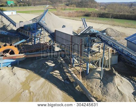 Elements of equipment for the extraction and sorting of rubble. Production of construction materials. Metal construction for working with stone and rocks. Slag of gravel under the conveyor belt poster