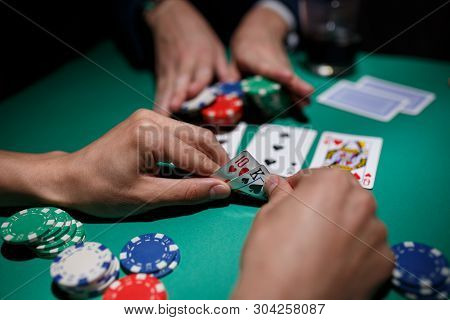 Poker Player Bets All Chips. Big Poker Risks. Poker Table And Hands Close-up