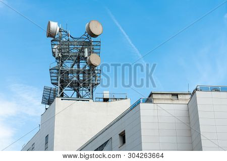 Telecommunication, Telephone Pole Or Communication Tower With Antennas On The Top Of Building Outdoo