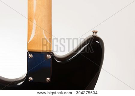Close Up Of Neck Plate On Black Electric Guitar With Bolt On Neck , Rear View, Studio Shoot.  Alder