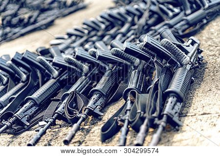 Lots Of Black Assault Rifle On The Ground. Concept Of The Right To Keep And Bear Arm Or Gun Of Secon