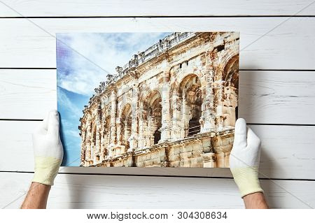 Photography Printed On Canvas With Gallery Wrap Method Of Canvas Stretching In Male Hands. Image Of