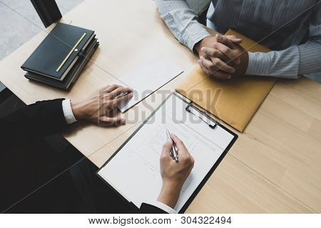 Boss sending a resignation letter to the employee on the table in the office. resignation concept. poster
