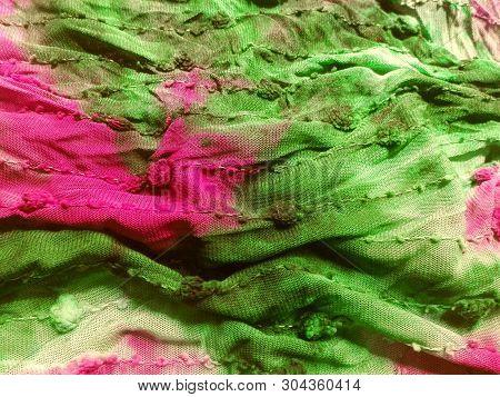 Cloth Mesh Stitch Pink Green Pattern Texture. Background Fabric Mesh Cloth Textile. Detail Close Tex