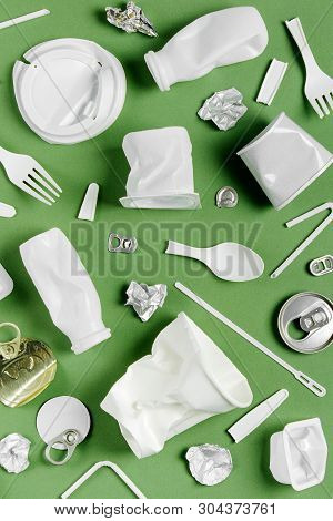 Plastic Waste Collection On  Green Background. Concept Of Recycling Plastic And Ecology. Flat Lay, T