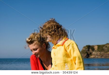 Mother and daughter at the sea.