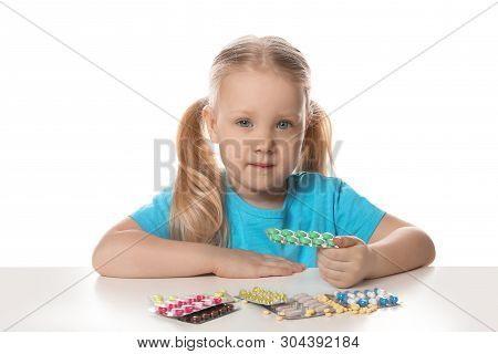 Little child with many different pills on white background. Danger of medicament intoxication poster