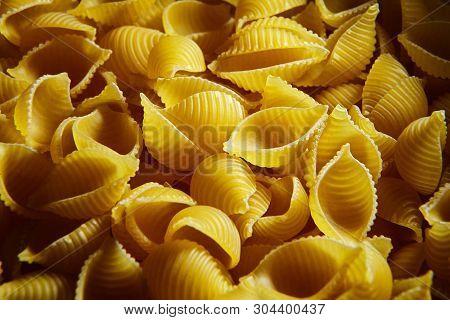Raw Uncooked Dry Conchiglioni Italian Pasta. Shells Shaped