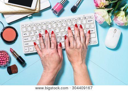 Woman Homeoffice Flat Lay Freelance Background. Keyboard,  Notepad, Rose Flower And Cosmetics On Blu