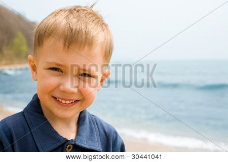 Smiling boy on a background of the sea.boy 4 years