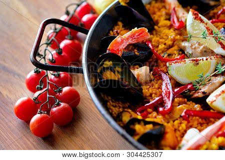 Delicious Spanish Seafood Paella, View From Top. Cooked With Sturgeon Halibut Fillet, Peeled Shrimps