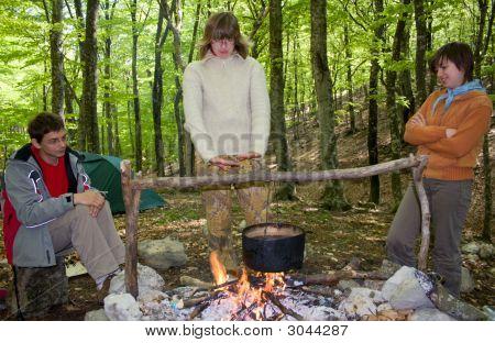 Three Tourist Near Of Fire