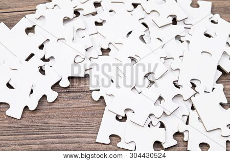 Image Shows Some Puzzle Parts On A Wooden Table