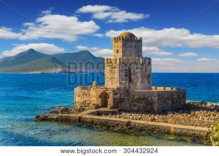 Magnificent three-tiered watchtower built on long cape in the sea. Venetian fort castle Methoni on the Greek Peninsula Peloponnese. The concept of active, photo and historical tourism