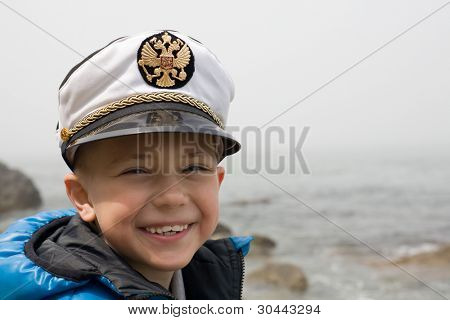 Little ship boy. Sea. Six years. Fog. At the cap emblem Russia. poster